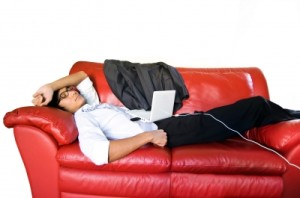 Man laying on couch relaxing